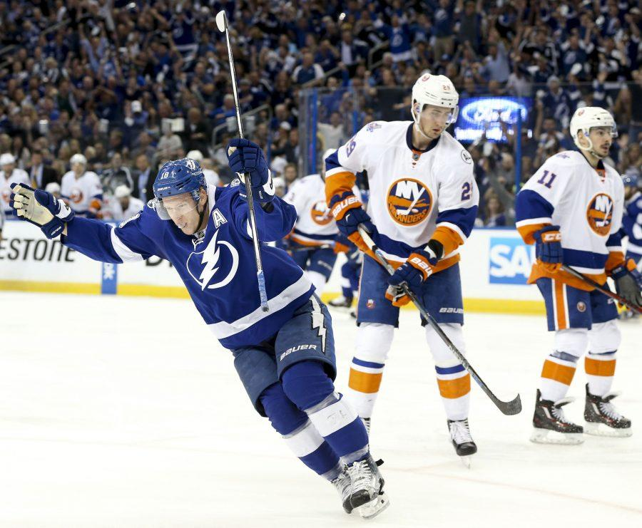Tampa Bay Lightning left wing Ondrej Palat (18) celebrates beating New York Islanders goalie Thomas Greiss (1) for the first goal of the game during the first period on Wednesday, April 26, 2016, at Amalie Arena in Tampa, Fla. (Dirk Shadd/Tampa Bay Times/TNS)