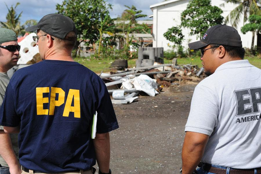 Pago Pago, American Samoa, October 2, 2009 – Chris Reiner, U.S. Environmental Protection Agency and a representative from American Samoa Environmental Protection Agency observe a hazardous waste collection center.  The containment of hazardous waste is an important step in the removal of debris.