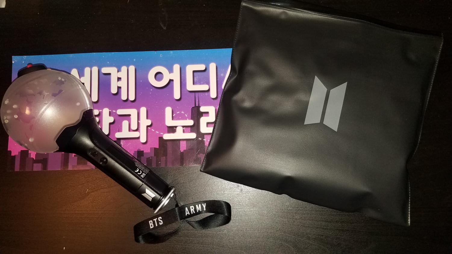 BTS merch and concert poster from their concert in Chicago, Illinois.