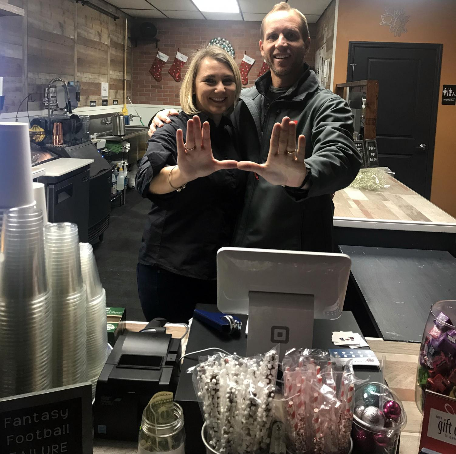 Vince Parisi and his wife Kristy Parisi together as the formal owners of the Canes Cafe'.