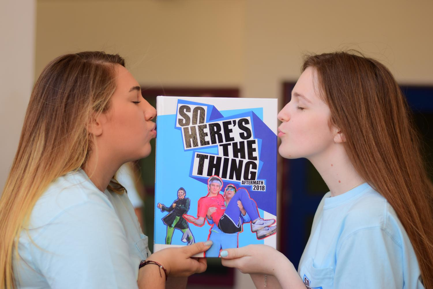 Hannah Pinnell ('20) and Rachel Giaquinto ('20) show their love for last years award winning yearbook.