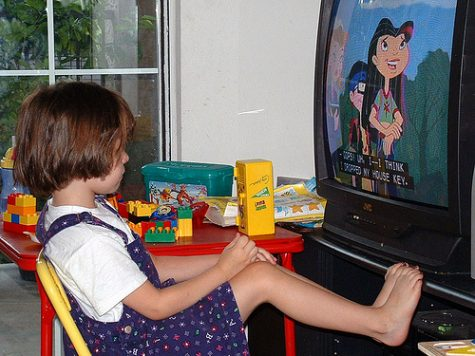 A kid watching an old 2000