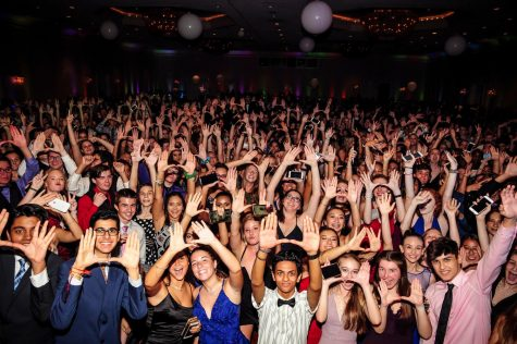 Students from last's years homecoming holding up